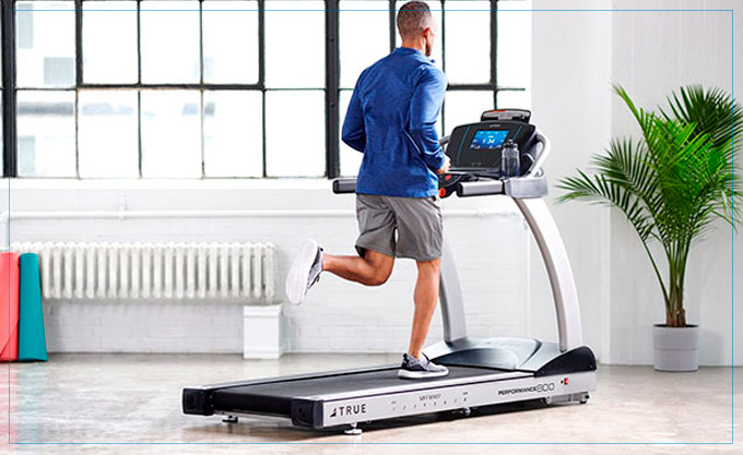 A man works out on a treadmill
